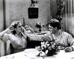 Jimmy Cagney gives Mae Clarke a grapefruit facial.