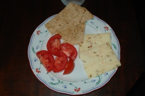 A Roma tomato, fragrant and almost sweet, is a good complement to the spicy cheese and nutty   tortilla